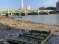 On the Thames riverbed, Shard in distance.